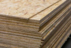 OSB - Oriented Strand Board. Sheet stack in a construction store. Engineered wood product for load-bearing applications in construction