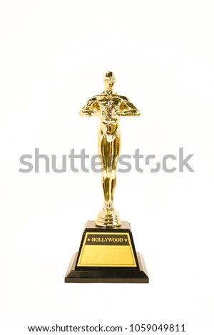 Oscar Academy award or Hollywood golden trophy isolated on a white background. Success and victory concept.