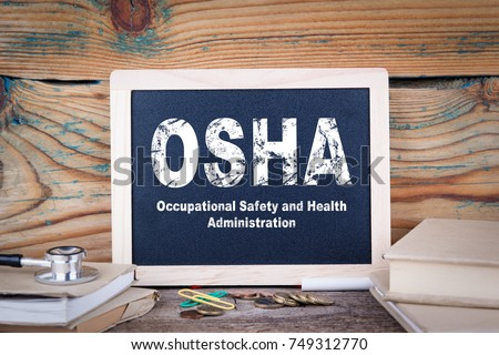 osha, Occupational Safety and Health Administration. Chalkboard on a wooden background