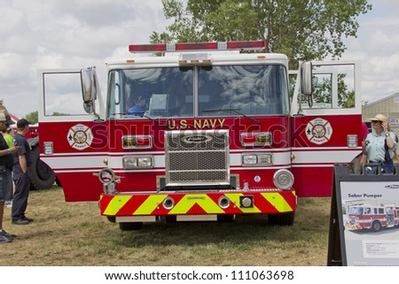 OSHKOSH, WI - JULY 27:  Front view of a Pierce red & white Fire Truck marked US Navy Pearl Harbor on display the 2012 AirVenture at EAA on July 27, 2012 in Oshkosh, Wisconsin.