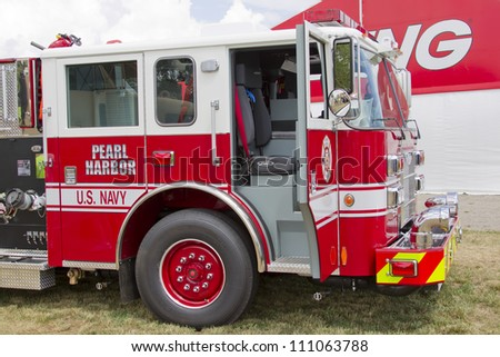 OSHKOSH, WI - JULY 27:  Side view of a Pierce red & white Fire Truck marked US Navy Pearl Harbor on display the 2012 AirVenture at EAA on July 27, 2012 in Oshkosh, Wisconsin.