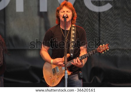 OSHKOSH, WISCONSIN - JULY 27: The Doobie Brothers, led by singer/guitarist Tom Johnston, perform a concert at EAA Airventure on July 27, 2009 in Oshkosh, Wisconsin.