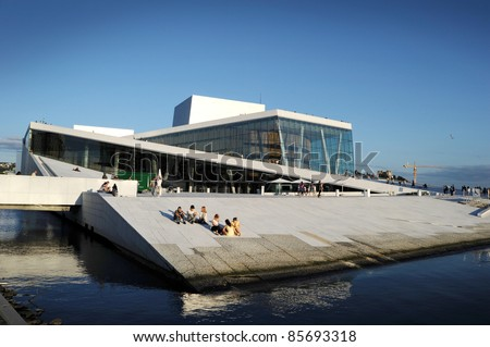 OSLO - AUGUST 15: People rest in front of the Oslo Opera House on August 15, 2010 in Oslo, Norway. The Oslo Opera House is the home of The Norwegian National Opera and Ballet, and the National Opera Theatre.