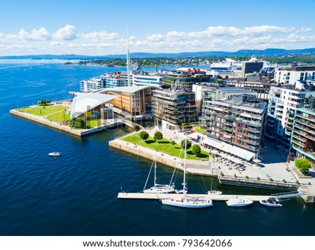 Oslo harbor or harbour at the Aker Brygge neighbourhood in Oslo. Oslo is the capital of Norway.