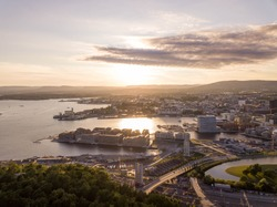 Oslo, Norway. Aerial view of Sentrum area of Oslo, Norway, with Barcode buildings and the river Akerselva. Construction site with blue sky during a sunny sunset,