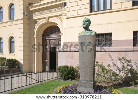 Oslo, Norway - April 21, 2015: Behind these doors, at The Norwegian Nobel Institute, the decision is made every year who will receive the Nobel Peace Prize. A bust of Alfred Nobel in the foreground.
