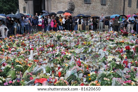 OSLO NORWAY - JULY 24 2011: People gather around the cathedral of Oslo to lay down flowers and to lit candles to show respect for the victims of the bombing and shooting that took place July 22 2011,  July 24, 2011, Oslo