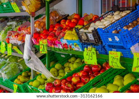 OSLO, NORWAY - 8 JULY, 2015: Typical vegetable market in Torggata where many immigrants run successfull food related businesses with a great variety of products.