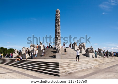 OSLO, NORWAY - JULY 16: Visitors enjoying the statues created by Gustav Vigeland in the popular Vigeland park in Oslo, Norway on July 16, 2011.