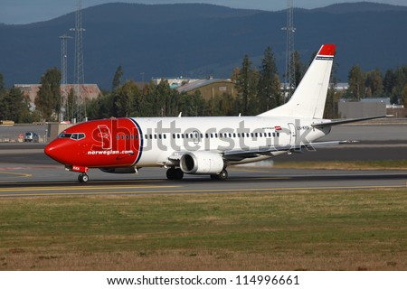OSLO - SEPTEMBER 16: A Norwegian Boeing 737 taxis on September 16, 2012 in Oslo, Norway. Norwegian is a low-cost carrier which operates with 64 aircraft and carried 15.7 million passengers in 2011.