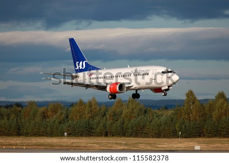 OSLO - SEPTEMBER 15: A SAS Scandinavian Airlines Boeing 737 on approach on September 15, 2012 in Oslo, Norway. SAS operates with 148 aircraft and carried 22.9 million passengers in 2011.