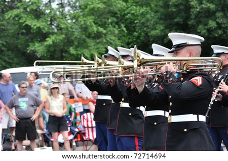OSSEO, MN - JUNE 26 : The USMC Marine Forces Reserve Band performs in the Osseo Marching Band Festival on June 26, 2010 in Osseo, MN