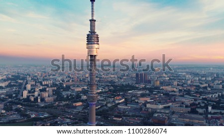 Ostankino TV Tower and beautiful Moscow sunset panorama with many buildings filmed at high altitude from the drone.