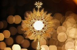 Ostensorium for worship at a Catholic church ceremony - sacred object of devotion and exposure of the Blessed Sacrament