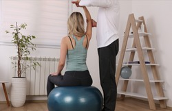 Osteopathy / Kinesiology treatment exercise ball. Sport Injury rehabilitation of athlete female patient.