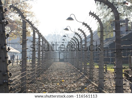 OSWIECIM, POLAND - OCTOBER 22: Electric fense in Auschwitz I, a former Nazi extermination camp on October 22, 2012 in Oswiecim, Poland. It was the biggest nazi concentration camp in Europe. - stock photo