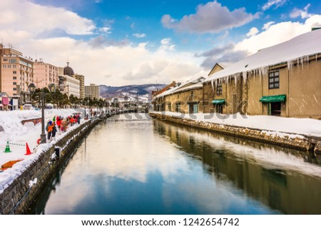 Otaru, Japan winter skyline on the canals.