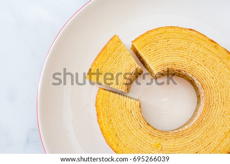 """Otaru's best known product is """"Yosei no Mori"""" (Forest of the Sprites) baumkuchen roll cake - made from Hokkaido ingredients, wrapped layer by layer, baked into a moist, soft cake resembling tree rings #695266039"""