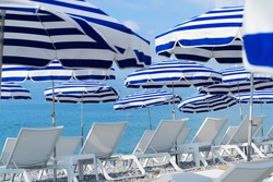 ote dAzur with striped beach umbrellas close up, France