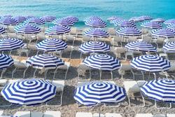 ote dAzur with striped beach umbrellas, France