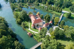 Otocec Castle ( Grad Otocec, Sankt Peter ) is 13th century catle in southeastern Slovenia. The castle is built on a small island in the middle of the Krka River.