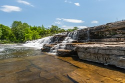 Otonabee Conservation Area featuring thinly bedded limestone waterfalls named Healey Falls on a sunny summer day
