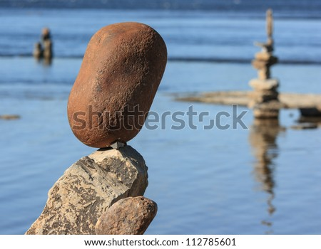 OTTAWA, CANADA - AUGUST 18: Piles of balanced stones at the International Stone Balance Festival at Remic Rapids and the Ottawa River on August 18, 2012 in Ottawa, Ontario.