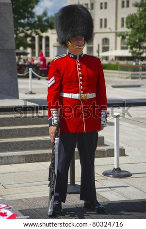 OTTAWA, CANADA - JULY 1:  A member of the Ceremonial Guard stands in full dress at the Tomb of the Unknown Soldier at the War Memorial in Ottawa, Ontario Canada on Canada Day, July 1, 2011.