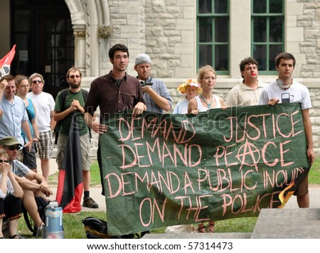 OTTAWA, CANADA - JULY 17: People gather to demand a public inquiry into police conduct at the recent G20 conference in Toronto.  July 17, 2010, in Ottawa, Ontario.