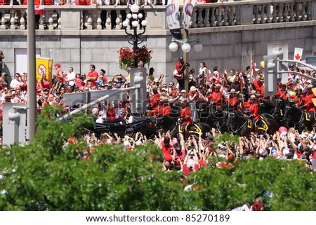 OTTAWA, CANADA – JULY 1: The Duke and Duchess of Cambridge travel by carriage on July 1, 2011 through Ottawa, Ontario. Ottawa was one of several cities they visited during their royal tour of Canada.
