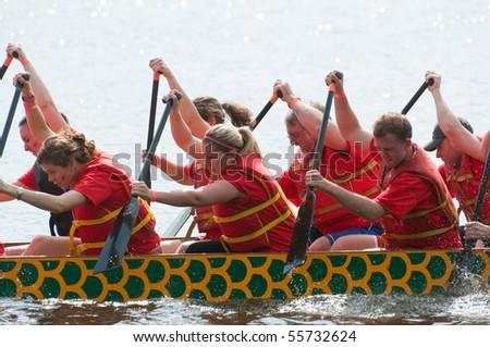 OTTAWA, CANADA - JUNE 19: Dragon Boat team in action at the Dragon Boat Race festival in Ottawa, Ontario June 19, 2010.