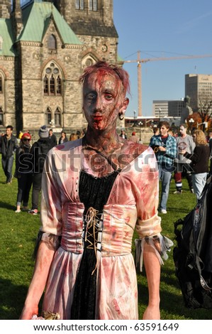 OTTAWA, CANADA - OCT 23:  Unidentified people dressed as zombies gather on Parliament Hill in Ottawa for the annual Zombie Walk, October 23, 2010 in Ottawa, Ontario.