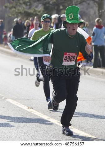 OTTAWA - MARCH 13: The annual running room Saint Patrick's Day 5k Marathon is held on March 13, 2010 in Ottawa, Canada.