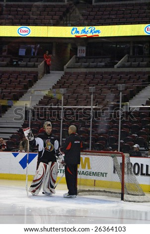 OTTAWA, ON - MAR 7: Ottawa Senators player Alex Auld converses with hockey trainer during a public hockey practice at Scotiabank Place March 7, 2009 in Ottawa, ON.