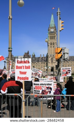 OTTAWA, ONTARIO - APRIL 17:  People protest against the civil war in Sri Lanka on April 17, 2009 in Ottawa, Ontario, Canada. The protesters demand to end attacks against Tamil citizens in Sri Lanka.