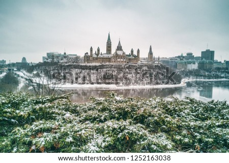 Ottawa Parliament in Winter . Cityscape of Canada's capital city, canadian travel destination in snow landscape.Mobile phone picture shot on Huawei mate pro 20. #1252163038