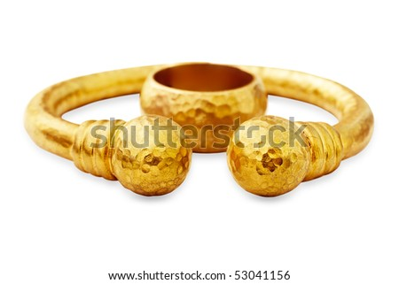 Ottoman style handcrafted solid silver plated with 22 karat gold bracelet and wedding ring on white background