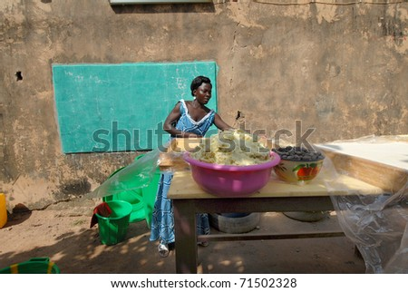 OUAGADOUGOU,BURKINA FASO -  MARCH 4: An African woman produces shea butter on March 4, 2005 in Ouagadougou, Burkina Faso. Shea Butter is used in Africa for food and is widely used in cosmetics as a moisturizer.