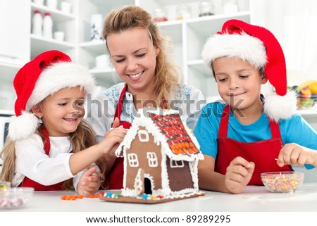Our christmas gingerbread cookie house - family in the kitchen at holidays time