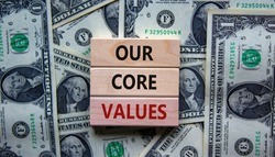 Our core values symbol. Concept words 'Our core values' on wooden blocks on a beautiful background from dollar bills. Business and our core values concept. Copy space.