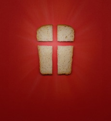 Our daily bread, a metaphor and sign. Cross, Christian values, Christian religion concept. Bread in the form of a cross on a red background, top view with copy space