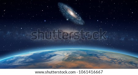 "Our Galaxy milky way against Andromeda galaxy ""Elements of this image furnished by NASA """