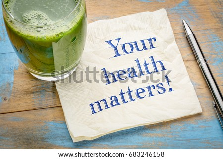 our health matters reminder or advice - handwriting on a napkin with a glass of fresh, green, vegetable juice