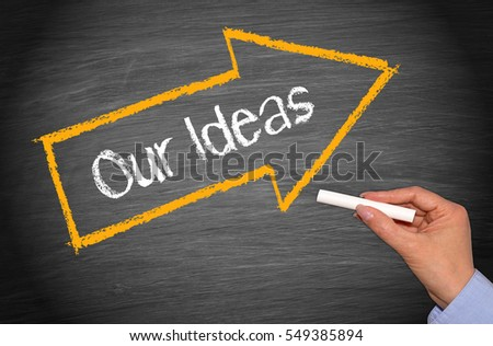 Our Ideas - blackboard with arrow and female hand with chalk stock photo