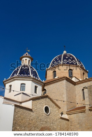 Our Lady of Solace Church with blue tiled domes and blue sky in old town of Altea, Costa Blanca, Spain