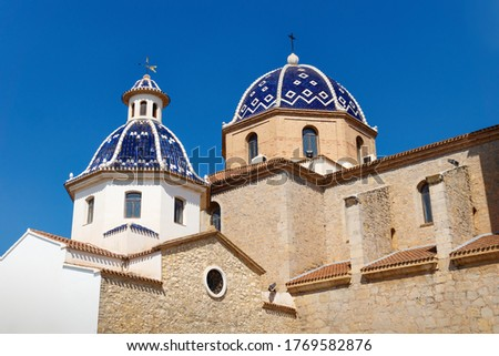 Our Lady of Solace Church with blue tiled domes and cloudless blue sky in Altea, Costa Blanca, Spain