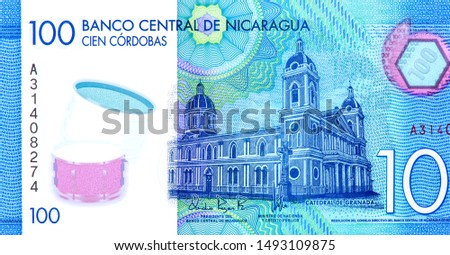 Our Lady of the Assumption Cathedral in Granada.  portrait from Nicaragua 100 Cordobas 2014 Banknotes. Nicaraguan money Closeup Collection. #1493109875