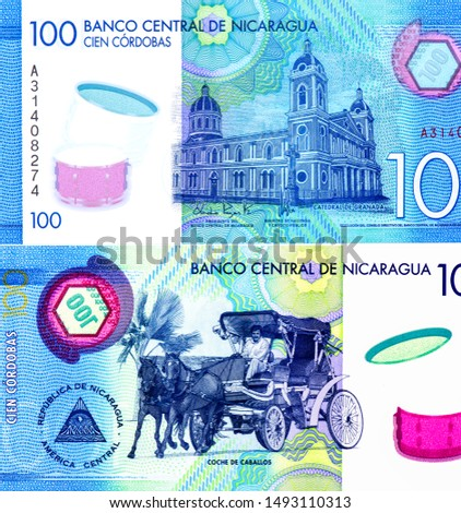 Our Lady of the Assumption Cathedral in Granada.  portrait from Nicaragua 100 Cordobas 2014 Banknotes. Nicaraguan money Closeup Collection. #1493110313