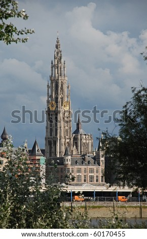 Our Lady's Cathedral and buildings on the river Scheldt in Antwerpe