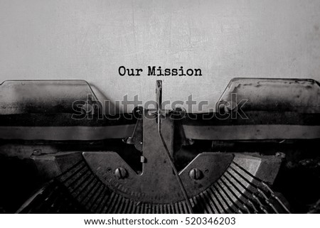 our mission typed words on a...